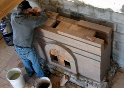 Building the baffle system for a masonry fireplace.