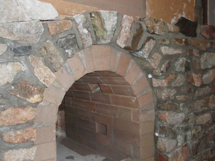 Stone arch on a masonry fireplace.