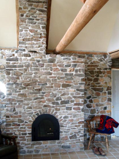 Finished masonry fireplace or masonry heater.